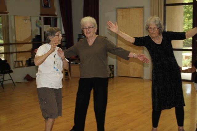 Jean Malamud, Dorothy Ross, and Janet Hilliard dance in Dance for Parkinson's classes.  Photo by Ruth Rosenberg.